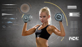 Happy young sporty woman exercising with dumbbells Stock Photo