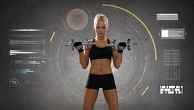 Happy young sporty woman exercising with dumbbells Royalty Free Stock Photography
