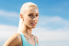Happy young sporty woman outside Stock Photography