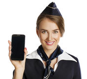Happy young stewardess holding a smart phone isolated on white b Stock Photo