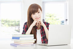 Happy young student girl at the classroom Stock Image