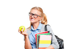 Happy young student girl holding books.  Back to school. Happy young student girl holding books, standing isolated on white background. Back to school Royalty Free Stock Image