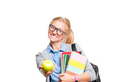 Happy young student girl holding books.  Back to school. Happy young student girl holding books, standing isolated on white background. Back to school Royalty Free Stock Photography