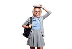 Happy young student girl holding books.  Back to school. Happy young student girl holding books, standing isolated on white background. Back to school Royalty Free Stock Photo