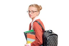 Happy young student girl holding books.  Back to school. Happy young student girl holding books, standing isolated on white background. Back to school Royalty Free Stock Images