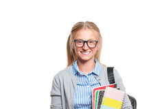 Happy young student girl holding books.  Back to school. Happy young student girl holding books, standing isolated on white background. Back to school Stock Photos