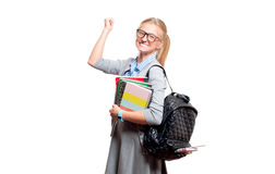 Happy young student girl holding books.  Back to school. Happy young student girl holding books, standing isolated on white background. Back to school Royalty Free Stock Photos