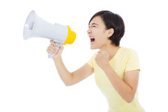 Happy young student girl standing and holding megaphone Royalty Free Stock Photo