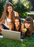 Happy young student girls outdoors Royalty Free Stock Images