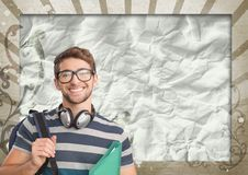 Happy young student man holding a folder against brown and white splattered background. Digital composite of Happy young student man holding a folder against Royalty Free Stock Photos