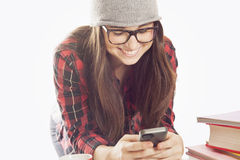 Happy young student with mobile phone Royalty Free Stock Photos