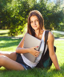 Happy young student outdoors i Stock Photos