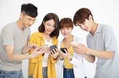 Young student people watching the smartphones. Happy young student people watching the smartphones stock photography