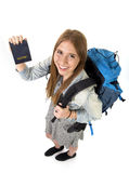 Happy young student tourist woman carrying backpack showing passport in tourism concept Stock Photography