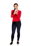 Happy young student woman holding piggybank Royalty Free Stock Photo