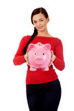 Happy young student woman holding piggybank Royalty Free Stock Photography