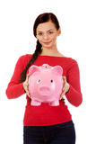 Happy young student woman holding piggybank Royalty Free Stock Photos