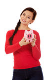 Happy young student woman holding piggybank Stock Images