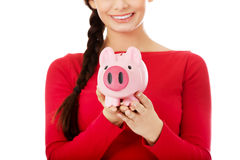 Happy young student woman holding piggybank Stock Photo