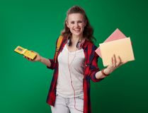 Happy young student woman chosen books instead of video game Stock Photo