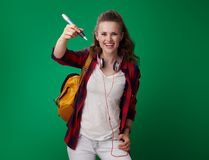 Happy young student woman writing in air with big pen Stock Photography