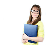 Happy young student women holding books in her hand while standing against white background royalty free stock photos