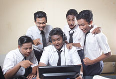 Happy young students are gather for studying internet communication technology in classroom royalty free stock image