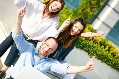 Happy young students with hands up. Happy young students smiling happy with hands up Stock Photo