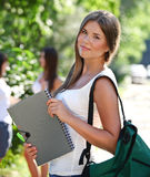 Happy young students outdoors Stock Photography