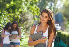 Happy young students outdoors Royalty Free Stock Images