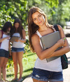 Happy young students outdoors Royalty Free Stock Image