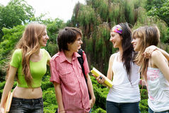 Happy young students in park Stock Photo