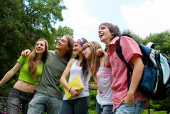 Happy young students in park Royalty Free Stock Photo
