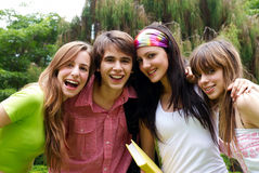 Happy young students in park Royalty Free Stock Image