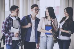 Happy Young Students are Speaking in the Hall. Frendship Concept. Studying in University. Happy Young People in College. Positivity Group. Yong Boys and Girls stock image
