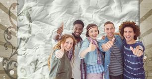 Happy young students standing against brown and white splattered background. Digital composite of Happy young students standing against brown and white Royalty Free Stock Image