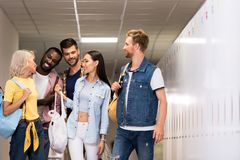 happy young students walking stock image
