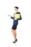 Happy young success business woman pointing on copy space Royalty Free Stock Photography