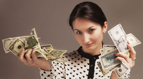Happy young successful Business Woman with money in hand Wealth. Abundance, happiness Stock Image
