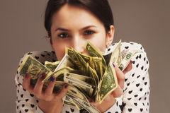 Happy young successful Business Woman sniffing the smell of mone. Y Wealth, abundance, happiness Stock Image