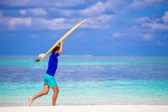 Happy young surf man at white beach with yellow Stock Photography