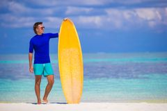Happy young surf man at white beach with yellow Stock Photos