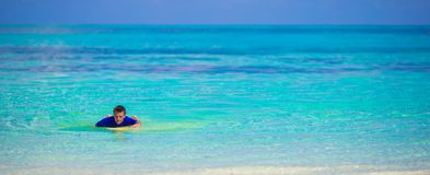 Happy young surf man at white beach with yellow Royalty Free Stock Image
