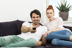 Happy Young Sweet Couple Sitting at the Couch Royalty Free Stock Image