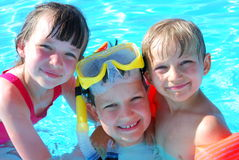 Happy young swimmers Stock Image