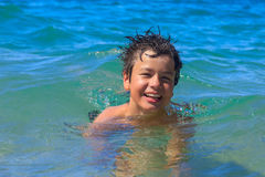 Happy young swims in the sea Stock Image
