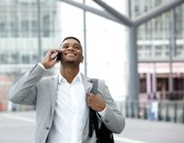 Happy young man talking on cellphone Stock Images