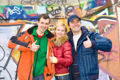 Happy young team backdrop graphite wall Royalty Free Stock Photo