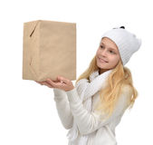 Happy young teen age girl with one parcel box isolates. On a white background Royalty Free Stock Photography