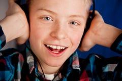 Happy Young Teenage Boy Wearing Headphones Stock Images